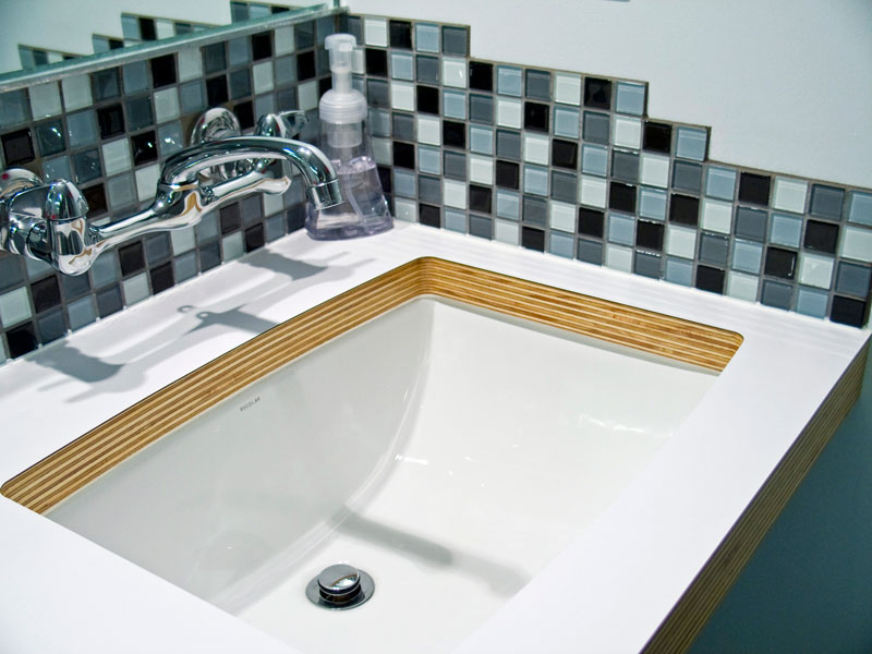 Bathroom renovation with corrugated metal, glass mosaic tile, custom cabinetry; www.justinbuilds.com