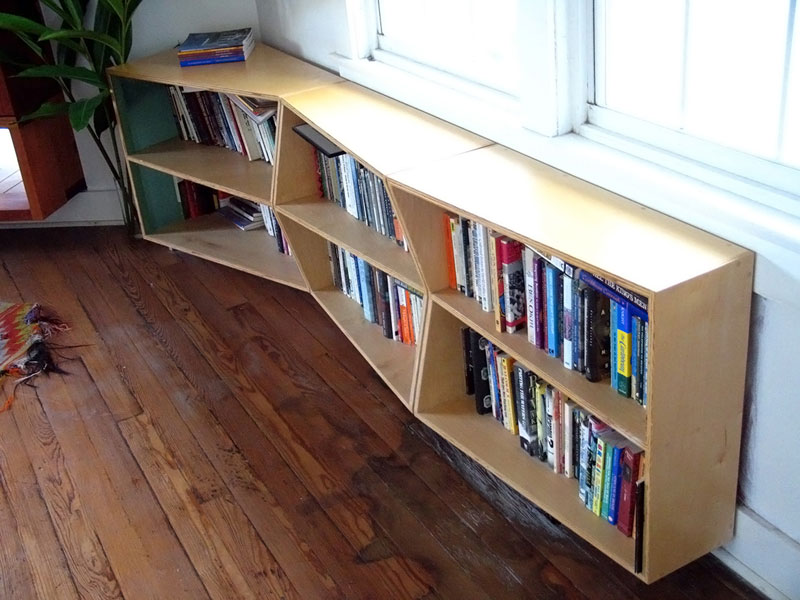 Custom undulating plywood bookshelf; www.justinbuilds.com
